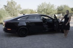 Jaguar Scottsdale car service with door held open